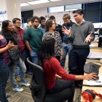 DAC Assistant Professors Dhruv Batra and Devi Parikh discuss their Visual Question Answering (VQA) project with students from thier Computer Vision Lab
